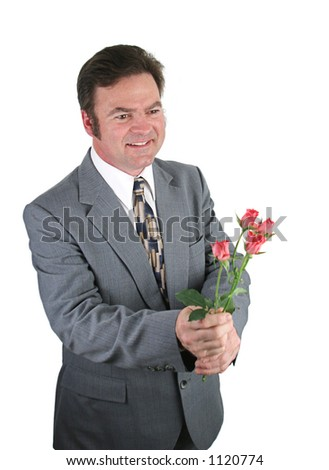 A handsome man in a suit bringing roses for his date. - stock photo