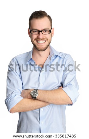 A handsome man in his 20s, wearing a blue shirt and glasses smiling. White background. - stock photo