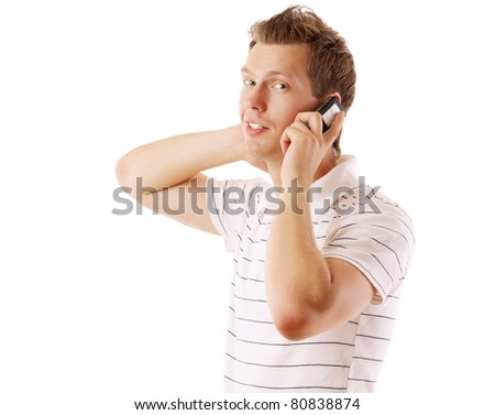 A handsome man is talking on phone on white background - stock photo