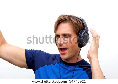 A handsome man jamming out to music