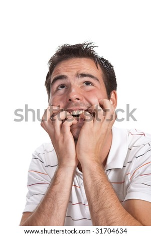 A handsome man looking away with hands on his cheeks - stock photo
