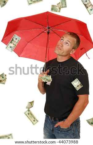 A handsome man looks in disbelief at money falling from the sky - stock photo