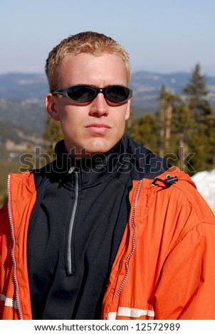 A handsome  man outdoors in the rocky mountains - stock photo