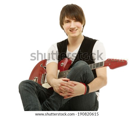 A handsome man playing a guitar, sitting isolated on white - stock photo