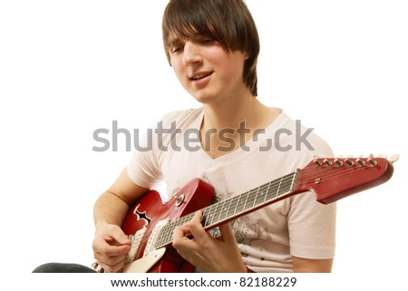 A handsome man playing guitar, isolated on white background - stock photo