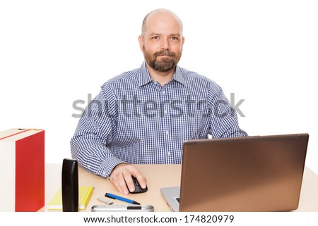A handsome man with a beard in his office isolated on white background