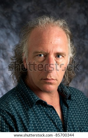 A handsome mature white american male wearing casual dress shirt looking at viewer. - stock photo