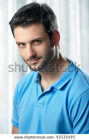 A handsome muscular man posing a neutral background with space for text