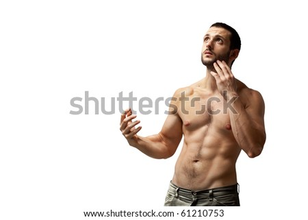 A handsome muscular man posing with his hand touching his face, isolated on white. - stock photo
