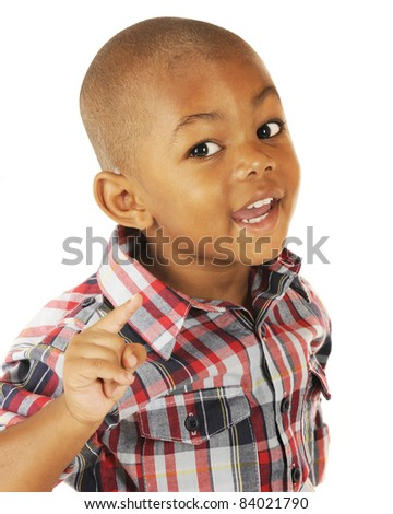 A handsome preschooler happily using his index finger when making his point. - stock photo