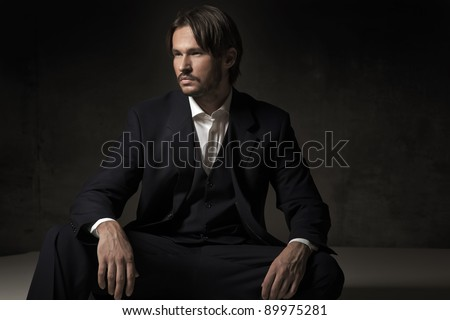 A handsome sitting man - stock photo