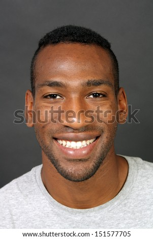 A handsome, smiling black man, headshot. - stock photo