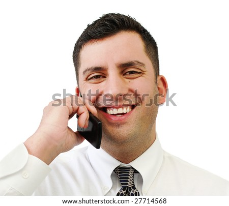 A handsome smiling businessman talking on his cell phone isolated over white - stock photo