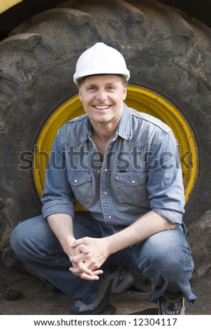 A handsome smiling construction worker. - stock photo