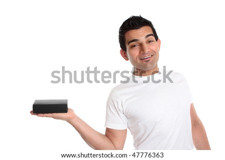 A handsome smiling man holds your packaged retail product in one hand. - stock photo