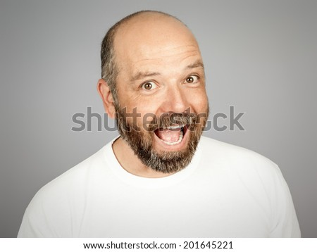 A handsome smiling man with a beard - stock photo