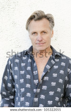 a handsome smiling mature man - stock photo