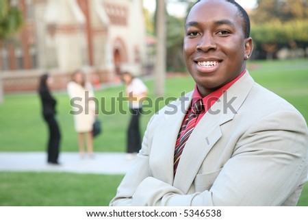 A handsome teacher on the school campus - stock photo