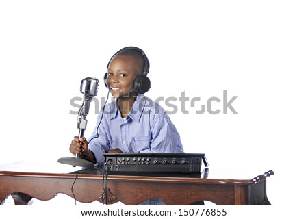 A handsome young African American happily working as a disc jockey.  On a white background. - stock photo