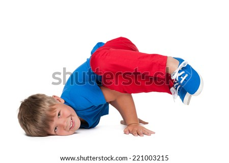 A handsome young boy is dancing on the white background - stock photo