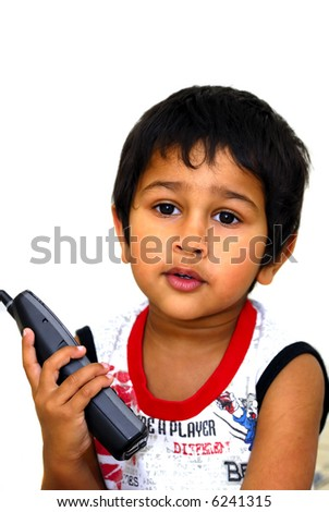A handsome young boy taking passionately on phone - stock photo