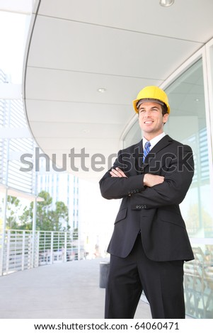 A handsome young business architect at construction site - stock photo