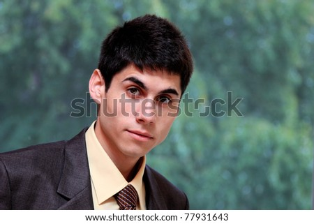 A handsome young businessman at the office
