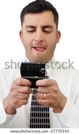 A handsome young businessman texting on his cell phone over white - stock photo