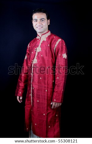 A handsome young Indian guy in a traditional attire. - stock photo
