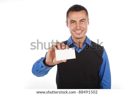 a handsome young man in a blue shirt with a business card in hand, isolated over white
