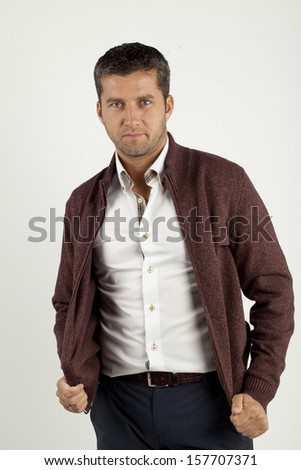 a handsome young man in shirt and vest