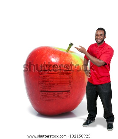 A handsome young man with an apple with a nutrition label