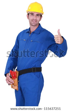 A handyman giving the thumb up. - stock photo