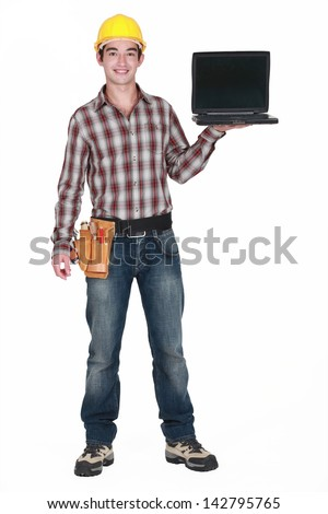 A handyman with a laptop. - stock photo