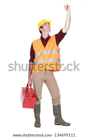 A handyman with a toolbox. - stock photo