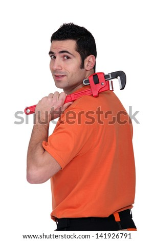 A handyman with a wrench. - stock photo