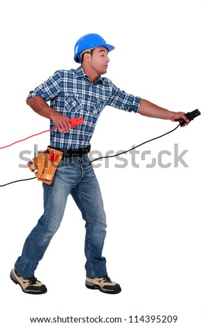 A handyman with power clamps. - stock photo