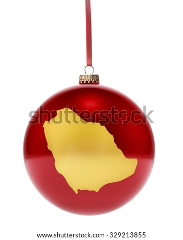 A hanging glossy red bauble with the golden shape of Saudi Arabia.(series) - stock photo