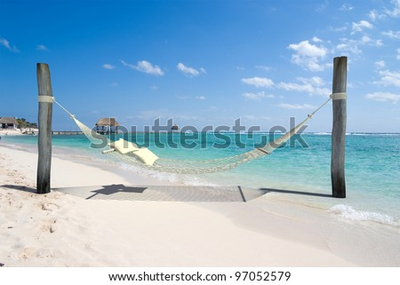 A hanging hammock, on a beach resort - stock photo