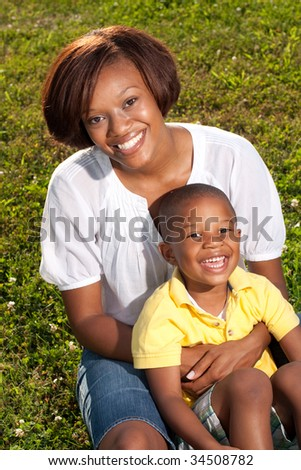 a happy african american mom poses with her son
