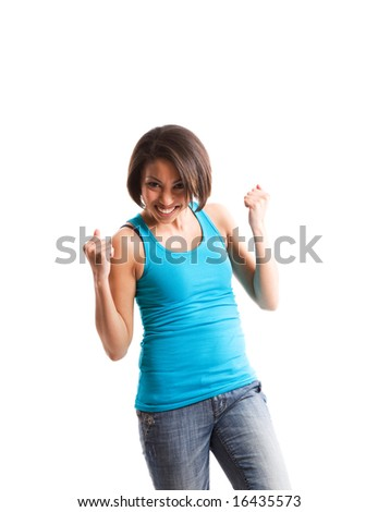 A happy african american woman pumps her fists