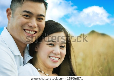 A happy and cheerful asian couple outdoor