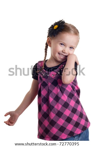 A happy and shy girl standing with a smile on her face.  The image is isolated on white. - stock photo