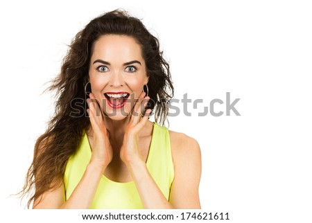 A happy and surprised beautiful woman looking at camera. Isolated on white. - stock photo