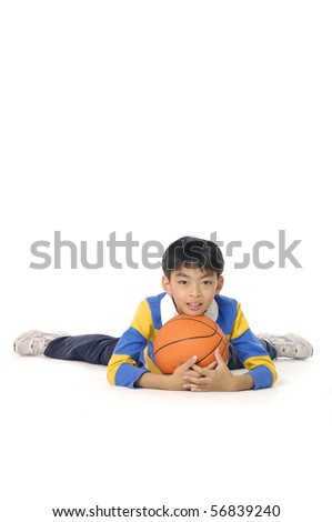 A happy asian little boy relaxing with his basketball - stock photo