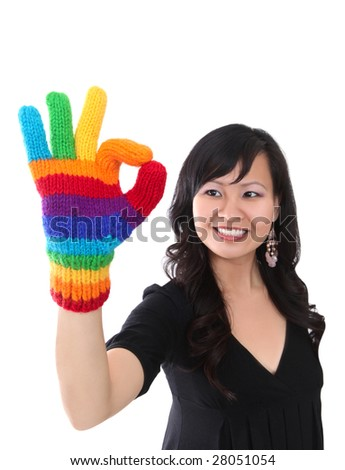A happy asian woman with rainbow gloves giving success gesture