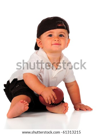 A happy baby boy proudly holding his football.  Isolated on white. - stock photo