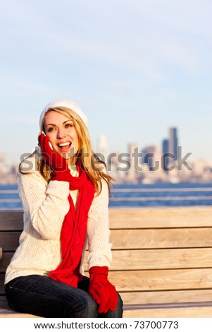 A happy beautiful Caucasian woman talking on her phone - stock photo