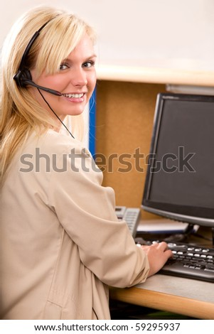 A happy bonde recpetionist with a phone headset - stock photo