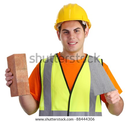 A happy builder with a brick, hardhat and tools - stock photo
